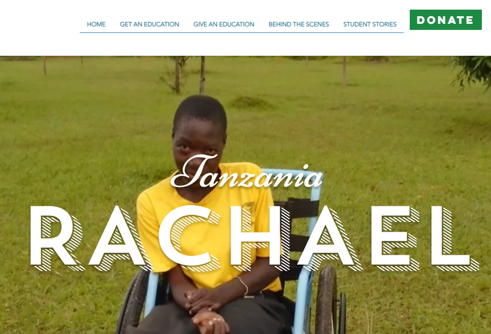 Rachael's sitting in front of beautiful African landscape in Tanzania. The Deaf Dream.