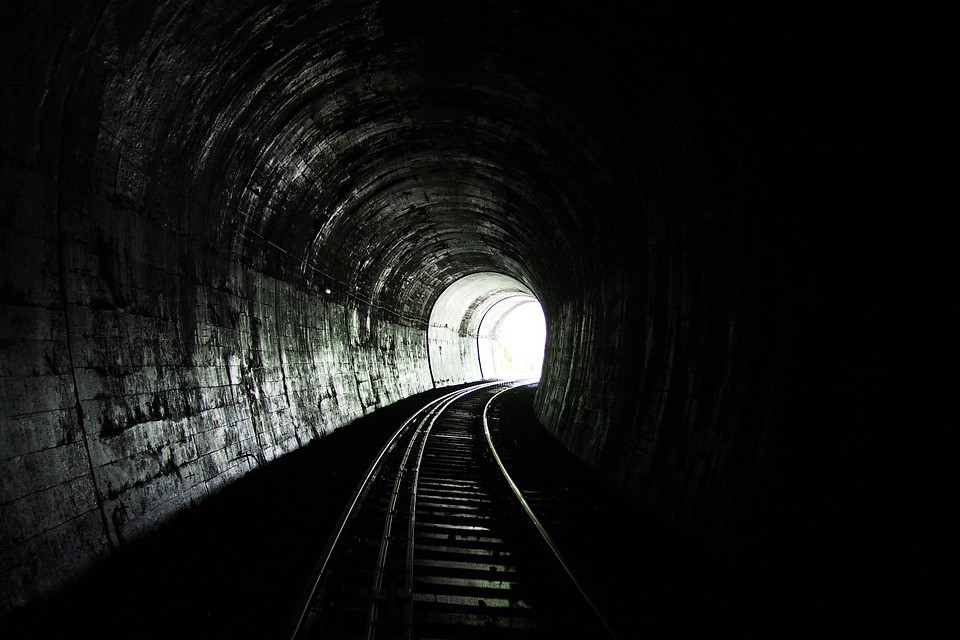 Black and white photo of dark tunnel with light at the end. Destiny Yarbro blog. Inspiration for your online projects.