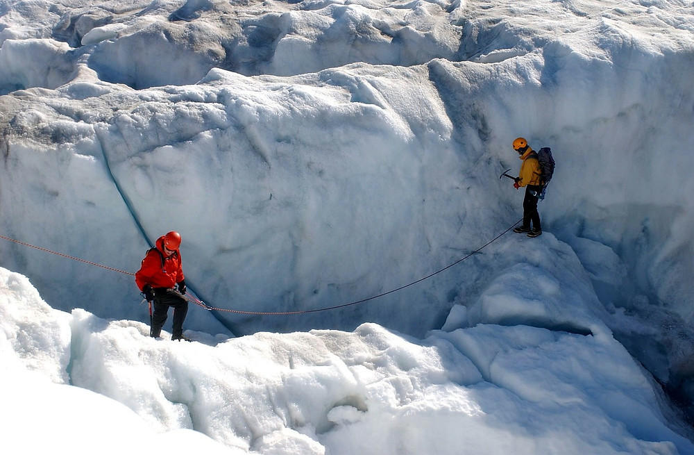Two men climbing ice in full climbing gear with connecting rope, working as a team.  3 Types of People You Need in Your Dream Support System [and Why You Shouldn't Tell Everyone Your Ideas]. Destiny Yarbro blog - serial-entrepreneur, author, speaker, and online business consultant.