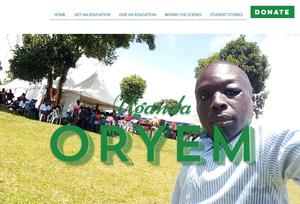 Oryem standing in front of Jerry's graduation ceremonies in Uganda. The Deaf Dream.
