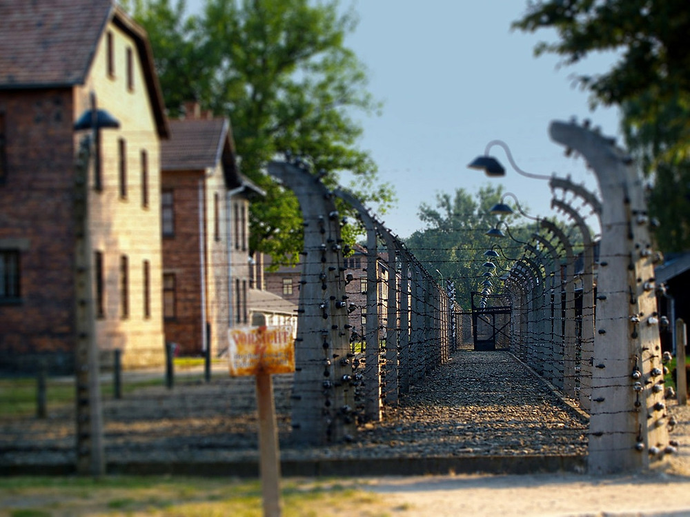 Photo of entry way to Auschwitz. Barbed ware fencing. Destiny Yarbro blog.