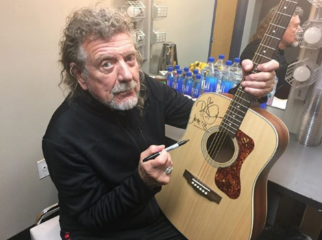 Robert Plant signing Guild Guitar from Westcoast Guitars