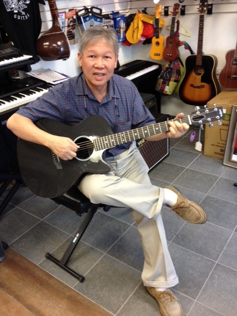 Happy RainSong customer at Westcoast Guitars.jpg