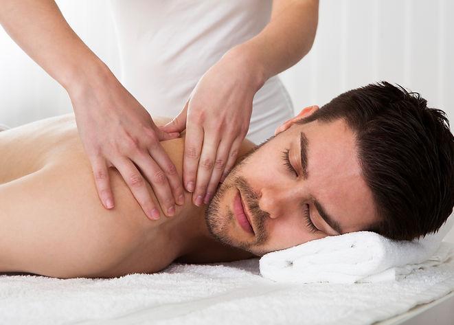 man receiving a deep tissue massage