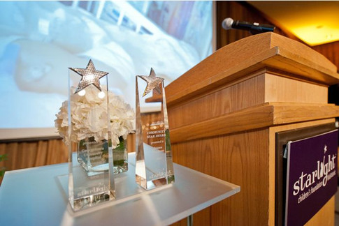 The awards given by Starlight to Georgetown Hospital and Franco Nuschese.