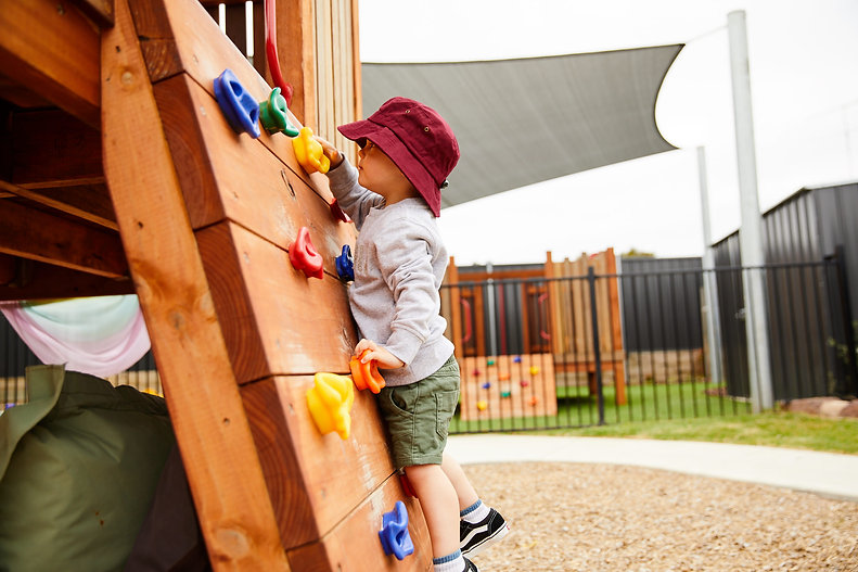 Child on a climbing wall at Leopold Early Learning Centre