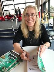 Helen signing Maddie.jpg