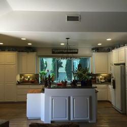 Fresh coat of paint, new lighting,  granite countertops  and you have an updated kitchen