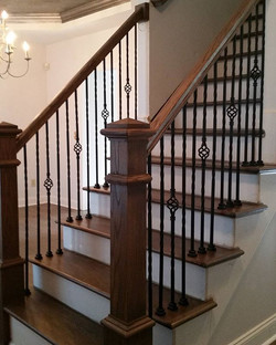 Simple but nice update to this staircase with new Newel post, double twist and single basket iron ba