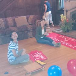 Phae & Meiko preparing the sign