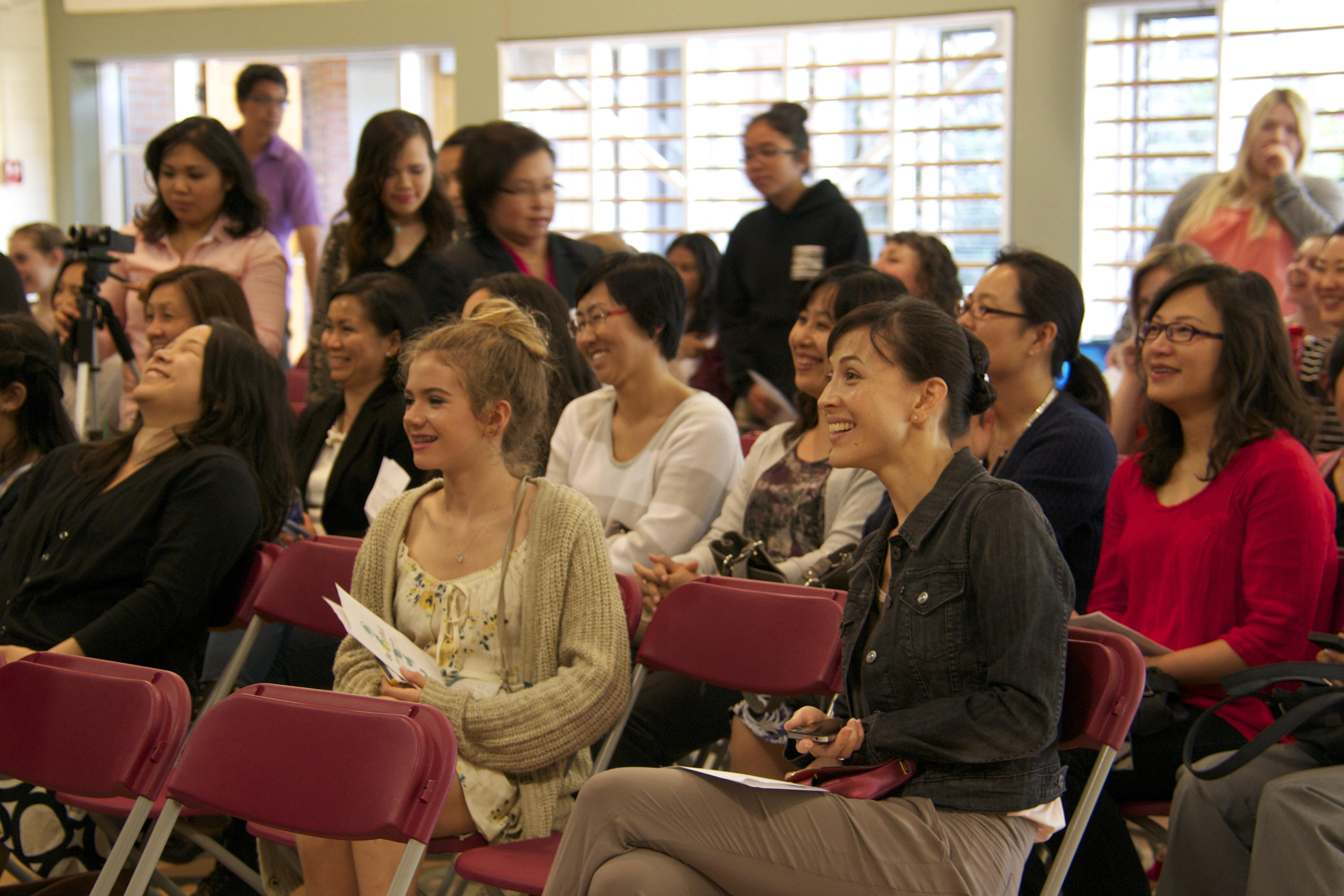 Audience members enjoying