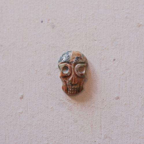 silver unakite skull gem