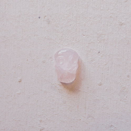 silver rose quartz skull gem