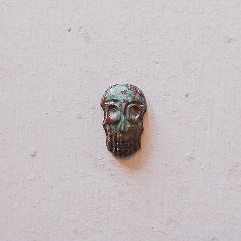 silver green and brown skull gem