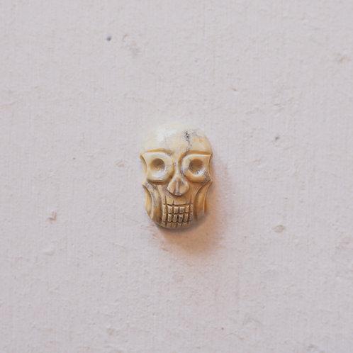 silver yellow howlite skull gem