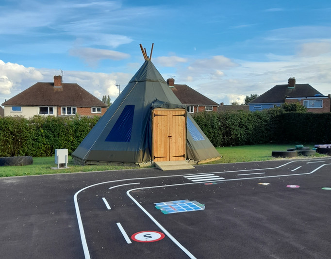 Khaki Tipi by a School Playground