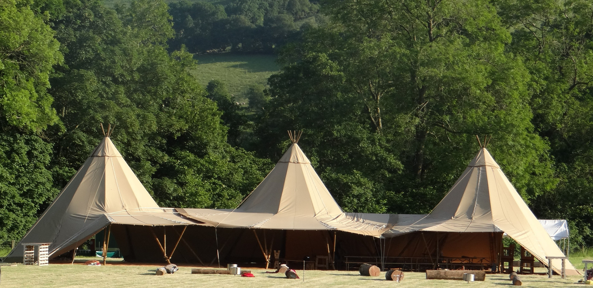Three Tipis in Liner Formation
