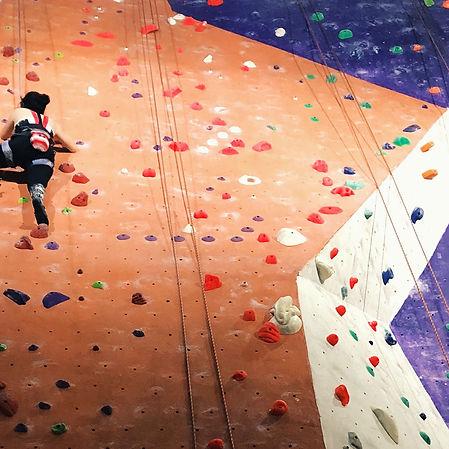 indoor climber on a climbing wall