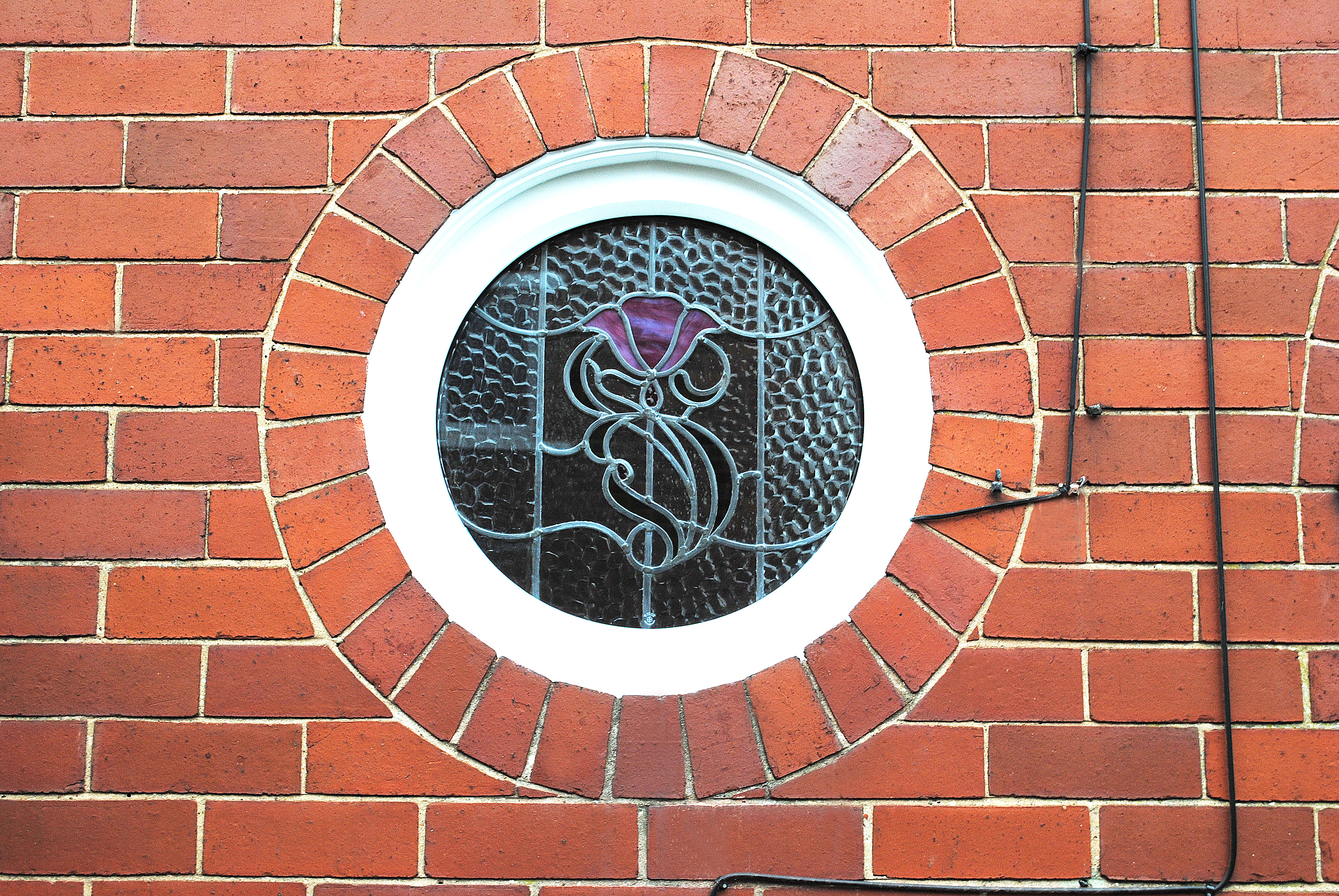 Circle window & Bespoke Rose Glass