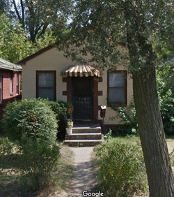 Brick ranch with 2 bedrooms with possibility for a third. 1 mile to Indiana University Northwest and