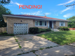 PENDING! Brick ranch on corner lot with basement and attached garage. A short distance to Marquette