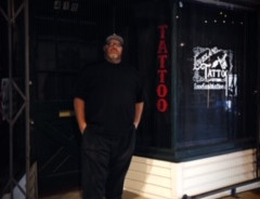 lil Pete of Loveland Tattoo Studio outside shop