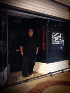 lil Pete of Loveland Tattoo Studio outside shop