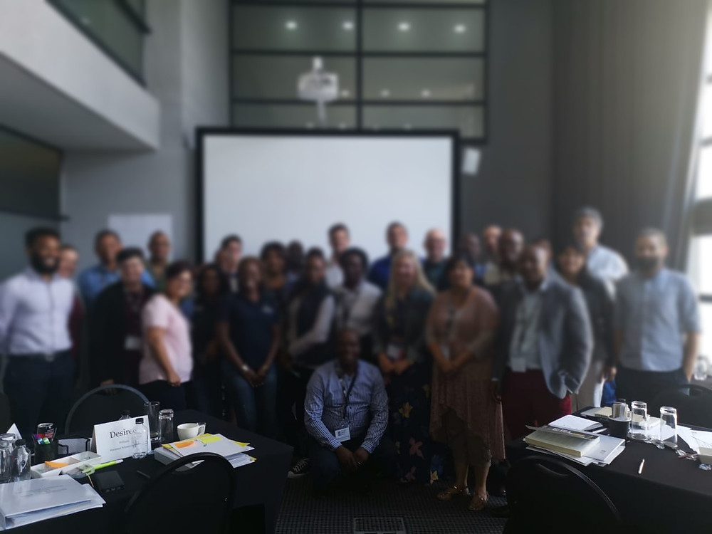 Coaches, principals and school leaders: group photograph at the second residential training course