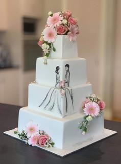 Handpainted wedding cake with fresh flowers