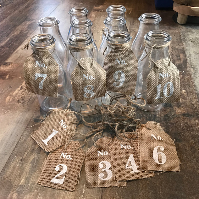 Flower bottles with table numbers .jpg