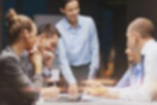 Business people in meeting room talking