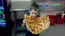 Payton going ham on a pizza at Yogi's