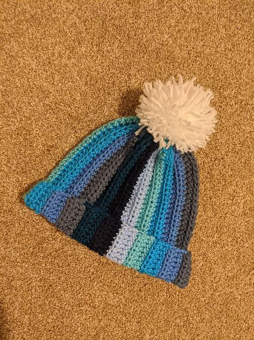 Shades of blue pom pom hat