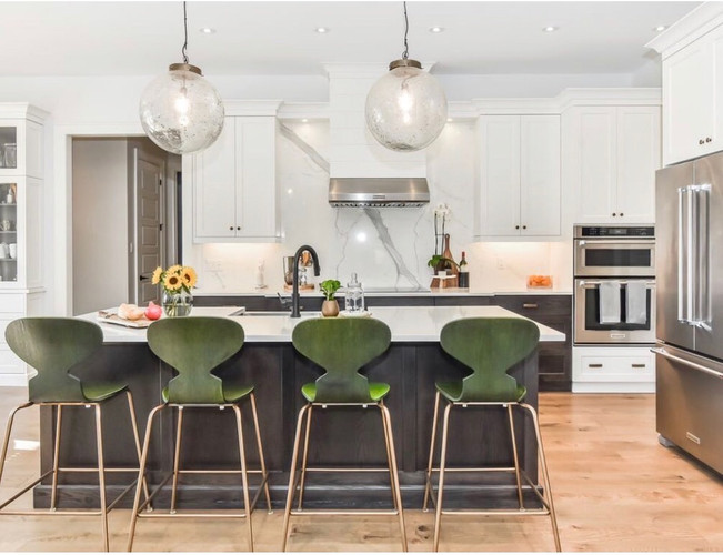 Kitchen with green stools