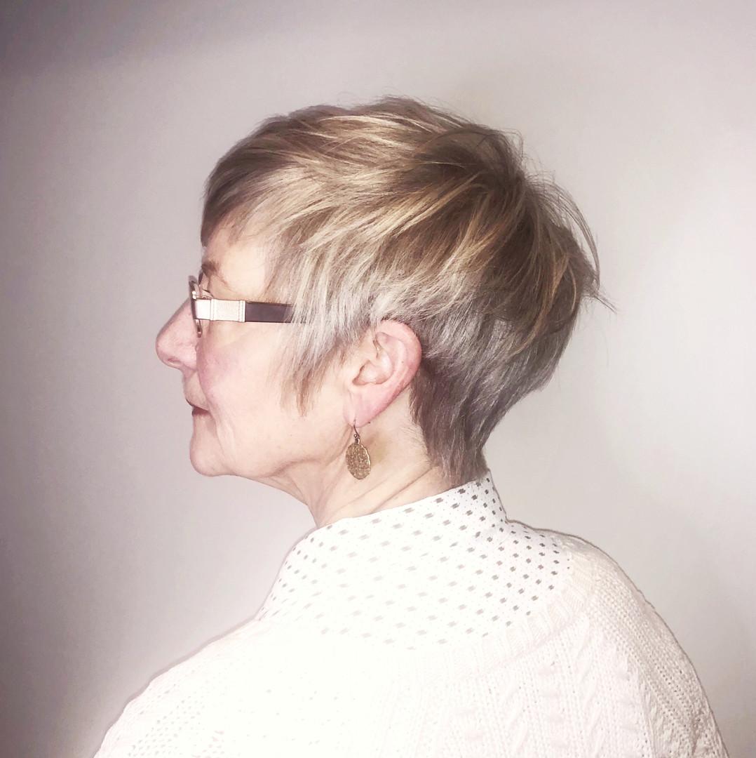 Blond, razor cut pixie