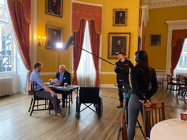 Behind the scenes shot including director and sound man and two actors (graham cole)