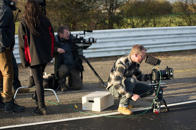 Charlotte Fantelli and crew filming on a race track
