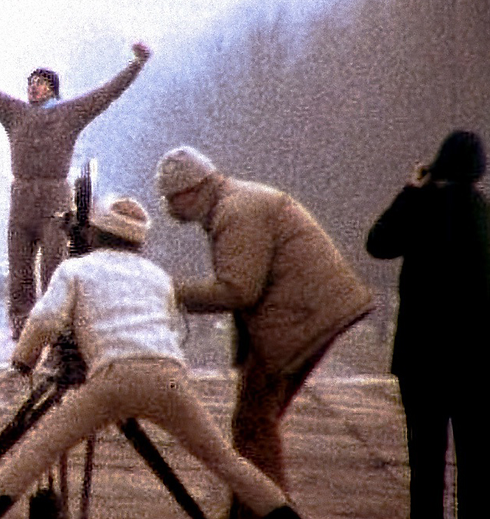 Shot from behind the scenes of Rocky showing camera men capturing Sylvester stallone acting in a scene