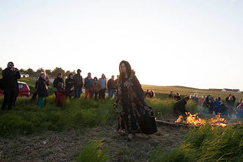 """Backfire, the fire line"", a Land Art performance by Inge Tranter at LAND-SHAPE Festival, Hanstholm 2015, Denmark. Photo: Morten Barker"