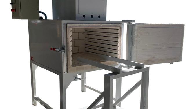 Horno eléctrico para limpieza de boquillas con adaptador para la carga.