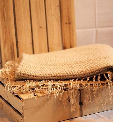 Tapis en fibre d'alpaga, couleur crème