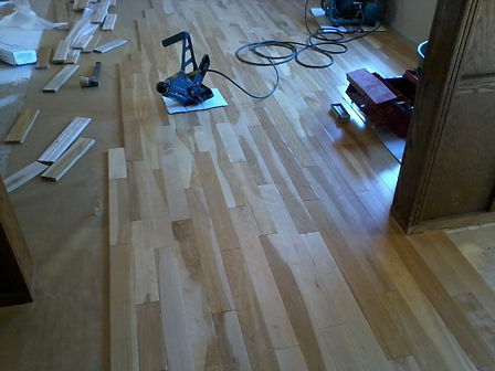 prefinish hardwood floros in Calgary installation