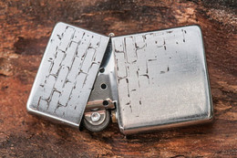Engraved lighter with brick motif