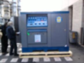 Tinosa employee inspecting Bauer Unicus III compressor