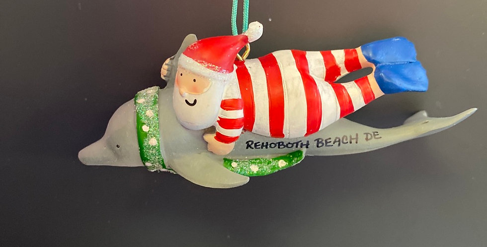Santa riding dolphin