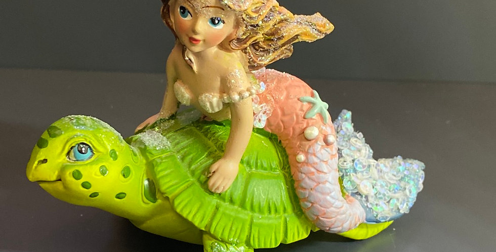 Mermaid riding turtle