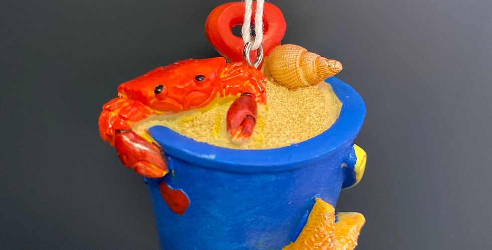 Blue bucket with starfish and crab