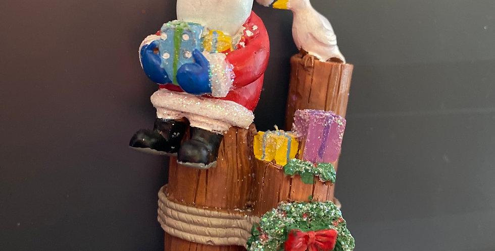 Santa on piling w Seagull