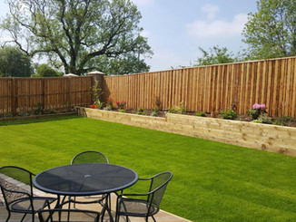 Residential lawn cutting and fenceline flowerbed addition
