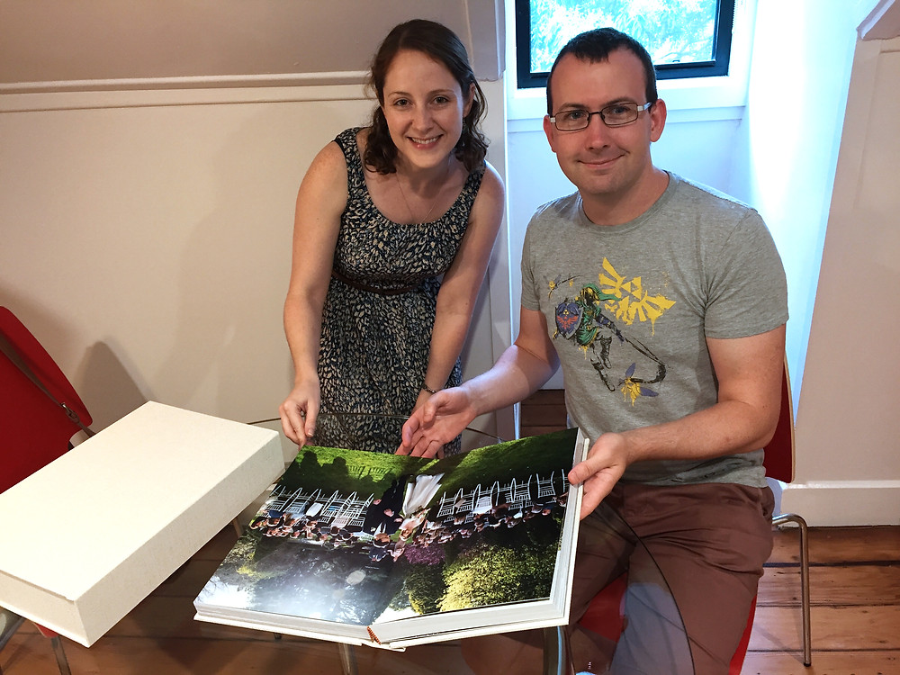 Elizabeth and Thomas receiving their album